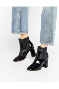 tendencias de zapatos, botas negras
